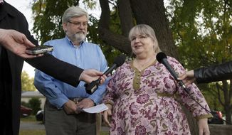 Linda and Patrick Boyle, parents of Joshua Boyle, speak with the media outside their home in Smiths Falls, Ontario, Thursday, Oct. 12, 2017. Canadian Joshua Boyle, his American wife Caitlan Coleman, and their three young children have been released after years held captive by a group that has ties to the Taliban and is considered a terrorist organization by the United States, U.S. and Pakistani officials said Thursday. (Adrian Wyld/The Canadian Press via AP)