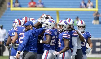 FILE - In this Sept. 10, 2017, file photo, Buffalo Bills players huddle before an NFL football game against the New York Jets in Orchard Park, N.Y. For a team that featured 29 newcomers on the roster to open the season, the Buffalo Bills have shown unexpected signs of being a close-knit group in getting off to a better-than-expected 3-2 start entering their bye week. (AP Photo/Adrian Kraus, FIle)