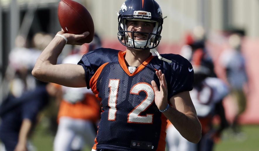 FILE - In this Aug. 16, 2017, file photo, Denver Broncos quarterback Paxton Lynch throws during a joint NFL football practice with the San Francisco 49ers in Santa Clara, Calif. Lynch resumed throwing this week for the first time since spraining his throwing shoulder in the preseason and he told The Associated Press on Thursday, Oct. 12, 2017, that he still aims to play this year. Lynch got hurt Aug. 26 in an exhibition game. (AP Photo/Marcio Jose Sanchez, File)