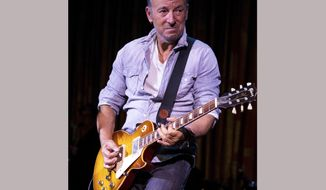 "FILE - In this April 21, 2017 file photo, Bruce Springsteen performs at The Asbury Park Music And Film Festival in Asbury Park, N.J. Springsteen makes his Broadway debut Thursday, Oct. 12, in a solo show in which he performs songs from his career, interspersed with readings of his best-selling memoir ""Born to Run.""  (Photo by Michael Zorn/Invision/AP, File)"
