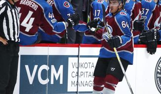 Colorado Avalanche right wing Nail Yakupov, of Russia, front, is congratulated as he passes the team box after scoring a goal against the Boston Bruins in the second period of an NHL hockey game Wednesday, Oct. 11, 2017, in Denver. (AP Photo/David Zalubowski)