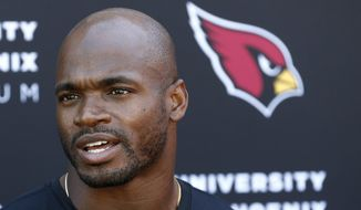 FILE - In this Oct. 11, 2017, file photo, Arizona Cardinals running back Adrian Peterson answers a question during an NFL football news conference at the team's training facility in Tempe, Ariz.  The Cardinals host the Tampa Bay Buccaneers on Sunday. (AP Photo/Ross D. Franklin, File) **FILE**