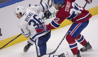 FILE- In this Sept. 27, 2017, file photo, Montreal Canadiens' Mark Streit, right, pushes Toronto Maple Leafs' Kerby Rychel during the second period of a preseason NHL hockey game in Quebec City, Quebec. A person with direct knowledge of the move tells The Associated Press the Canadiens have placed Streit on waivers. The person spoke on the condition of anonymity Wednesday, Oct. 12, 2017, because the Canadiens have not announced the move. The abrupt move comes four months after Montreal signed the 39-year-old Streit to a one-year contract in free agency (Jacques Boissinot/The Canadian Press via AP, File)
