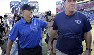 FILE- In this Oct. 23, 2016, file photo, Indianapolis Colts head coach Chuck Pagano, left, meets Tennessee Titans head coach Mike Mularkey on the field after the Colts beat the Titans 34-26 in an NFL football game in Nashville, Tenn. No matter the coaches, the players or even the city, one thing remains unchanged when the Colts play the Titans. The Colts win. (AP Photo/James Kenney, File)