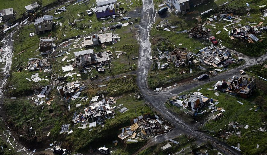 In this Thursday, Sept. 28, 2017, file photo, destroyed communities are seen in the aftermath of Hurricane Maria in Toa Alta, Puerto Rico. (AP Photo/Gerald Herbert, File)