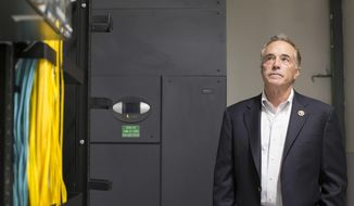 In this May 27, 2015, file photo, Republican Rep. Chris Collins visits to a Yahoo! datacenter in Lockport, N.Y. (Joed Viera/The Union-Sun & Journal via AP) ** FILE **