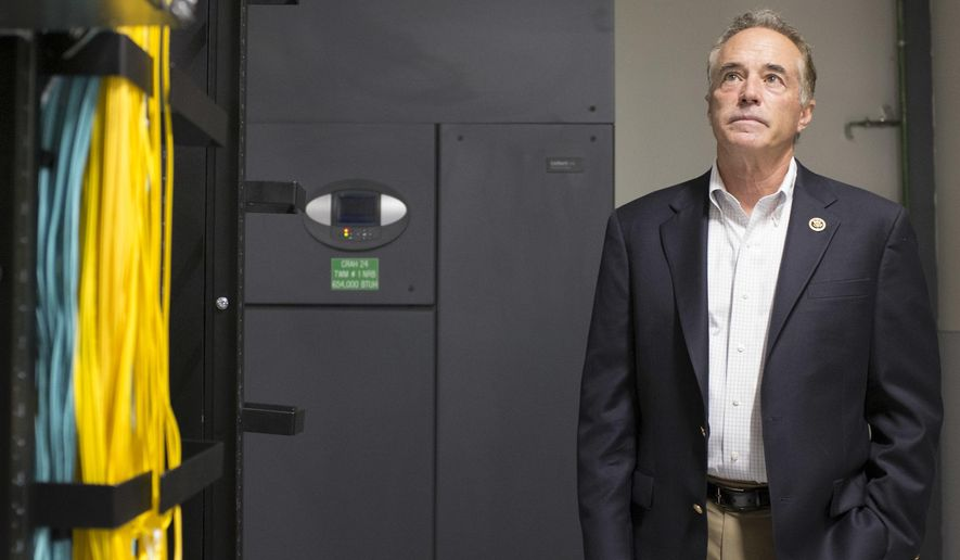 """In this May 27th, 2015, photo, Republican Rep. Chris Collins visits to a Yahoo! datacenter in Lockport, N.Y. Congressional investigators say there is a """"substantial reason to believe"""" Collins of New York shared material, non-public information about a drug company he had a major financial stake in and took official actions to assist the company. (Joed Viera/The Union-Sun & Journal via AP)"""