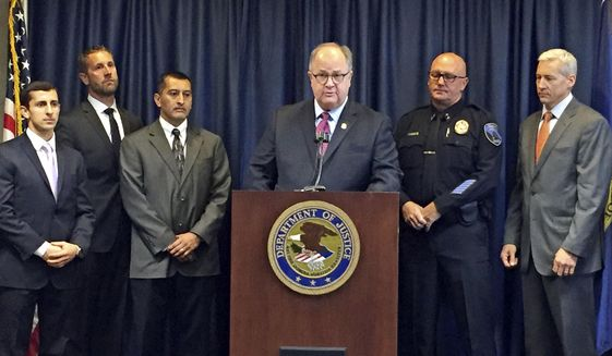 U.S. Attorney for Idaho Bart Davis, center at podium, speaks during a press conference in Boise, Idaho, on Thursday, Oct. 12, 2017. Davis said he believes a new offshoot of the street and prison gang Surenos is close to being eradicated after a series of indictments in state and federal court.  Also pictured from left to right are: Special Assistant U.S. Attorney Francis Zabari, Alcohol Tobacco and Firearms agent Ken Cooper, Idaho Department of Correction Director Henry Atencio, Davis, Caldwell Police Chief Frank Wyant and FBI supervisor senior resident agent Doug Hart. (AP Photo/Rebecca Boone)