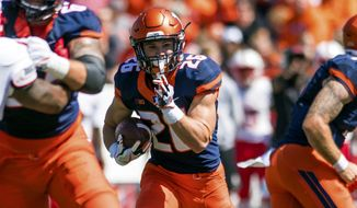 FILE - In this Sept. 2, 2017, file photo, Illinois running back Mike Epstein (26) runs the ball during an NCAA college football game against Ball State at Memorial Stadium in Champaign, Ill. The Illinois offense is ranked last in the Big Ten, but not because of the run game. Illinois piled up 200 rushing yards in a loss at Iowa last weekend, using primarily three running backs to do it. The Illini are hoping to ride the run to a win at home against Rutgers this Saturday.(AP Photo/Bradley Leeb, File)