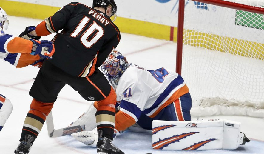 New York Islanders goalie Jaroslav Halak, right, blocks a shot by Anaheim Ducks right wing Corey Perry during the third period of an NHL hockey game in Anaheim, Calif., Wednesday, Oct. 11, 2017. (AP Photo/Chris Carlson)