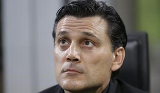 FILE - In this Thursday, Sept. 28, 2017 file photo, AC Milan head coach Vincenzo Montella looks up prior to the Europa League group D soccer match between AC Milan and Rijeka, at the Milan San Siro Stadium, Italy.  Vincenzo Montella is Milan's sixth coach since current Juventus manager Massimiliano Allegri was fired in January, 2014. (AP Photo/Luca Bruno, File)
