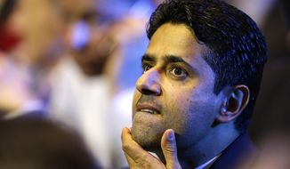 FILE - In this Aug.25, 2016 file photo, President of Paris Saint-Germain soccer club, Nasser Al-Khelaifi, gestures during the UEFA Champions League draw at the Grimaldi Forum, in Monaco. Swiss federal prosecutors have announced Thursday Oct.12, 2017 a criminal case for suspected bribery linked to World Cup broadcast rights against Nasser Al-Khelaifi. (AP Photo/Claude Paris, File)
