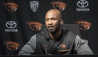 In this photo taken Oct. 9, 2017, Oregon State interim football coach Cory Hall speaks at a news conference in Corvallis, Ore., after head football coach Gary Andersen agreed to mutually part with the university. (Andy Cripe/The Corvallis Gazette-Times via AP)