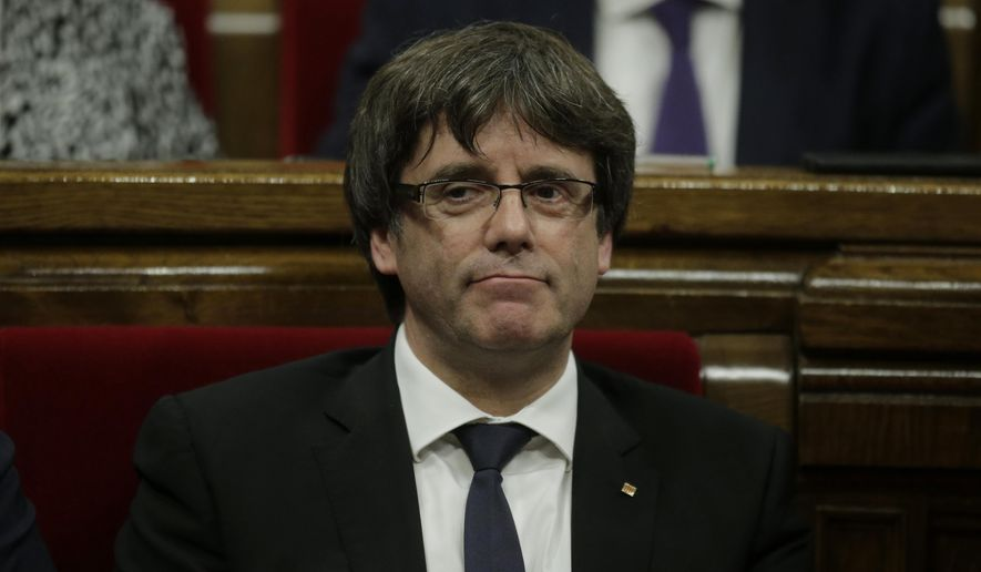 "Catalan regional President Carles Puigdemont waits to make his opening speech at the parliament in Barcelona, Spain, Tuesday, Oct. 10, 2017. Puigdemont says he has a mandate to declare independence for the northeastern region, but proposes waiting ""a few weeks"" in order to facilitate a dialogue. (AP Photo/Manu Fernandez)"