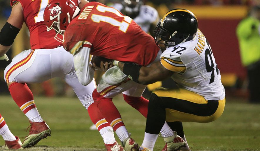FILE - In this Jan. 15, 2017, file photo, Pittsburgh Steelers outside linebacker James Harrison sacks Kansas City Chiefs quarterback Alex Smith (11) during the second half of an NFL divisional playoff football game, in Kansas City, Mo.  The unbeaten Chiefs are eying some revenge when the Steelers roll into town Sunday. It was Pittsburgh that knocked the AFC West champs out of the playoffs last season. (AP Photo/Orlin Wagner)