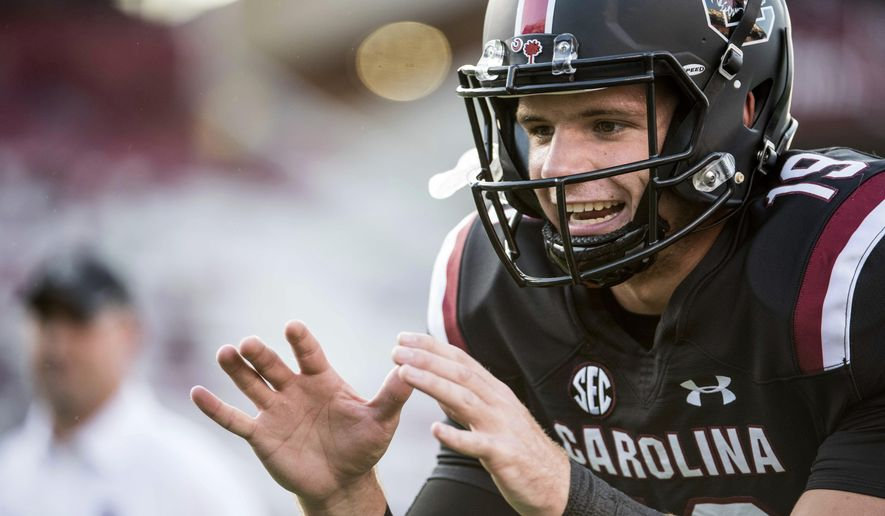 FILE - In this Sept. 16, 2017, file photo, South Carolina quarterback Jake Bentley (19) takes a snap before kickoff of an NCAA college football game against Kentucky, in Columbia, S.C. After getting a firsthand look at how a quarterback switch caused South Carolina to heat up late last season, Tennessee is hoping its own shake-up provides a similar spark. South Carolina was 2-4 last season when the Gamecocks abandoned plans to redshirt Jake Bentley and moved the freshman to the top of their depth chart. Tennessee now wants to flip the script, as redshirt freshman Jarrett Guarantano makes his first career start Saturday when the Volunteers host the Gamecocks. (AP Photo/Sean Rayford, File)