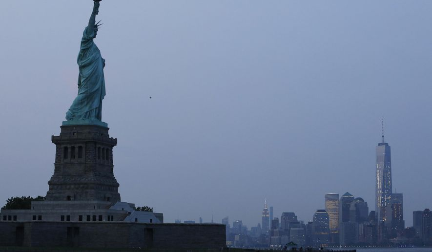FILE - In this Tuesday, July 7, 2015, file photo, the Statue of Liberty stands in New York harbor with the New York City skyline in the background. UNESCO is known for proclaiming World Heritage sites _ places like the Egyptian pyramids or the Statue of Liberty that are conferred a special U.N. status. (AP Photo/Kathy Willens, File)