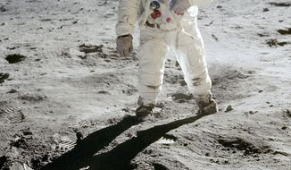 In this 1969 photo released by NASA, astronaut Buzz Aldrin walks on the surface of the moon near the leg of the lunar module Eagle during the Apollo 11 mission. Astronaut Neil Armstrong, who took the photograph, is reflected in Aldrin's visor. From Thursday, Oct. 12, 2017 through Nov. 2., Skinner Auctioneers and Appraisers is selling more than 400 vintage prints of photos, including the photo of Aldrin, made by American astronauts from 1961 to 1972. (Neil Armstrong/NASA via AP)