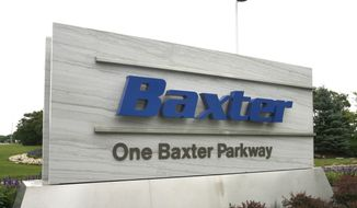This July 2009 photo shows the sign outside Baxter International Inc. in Deerfield, Ill. Drug and medical product maker Baxter says it expects a near-term shortage of small bags of saline solution, widely used in hospitals to hydrate patients and mix with intravenous medicines, due to Hurricane Maria temporarily shutting down its operations in Puerto Rico. (George LeClaireDaily Herald via AP)