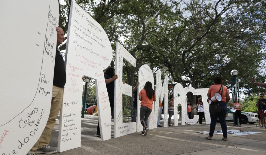 "Immigrant rights supporters hold giant letters reading ""Dream Act"" as they demonstrate in favor of Congress passing a 'Clean Dream Act' that will prevent the deportation of young immigrants known as Dreamers working and studying in the U.S.,Friday, Oct. 13, 2017, in Miami. President Trump announced plans to end a program protecting them. (AP Photo/Lynne Sladky) **FILE**"