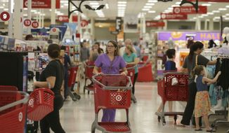 Shoppers make their way through a Target store in Dallas, Friday, Oct. 13, 2017. (AP Photo/LM Otero) ** FILE **