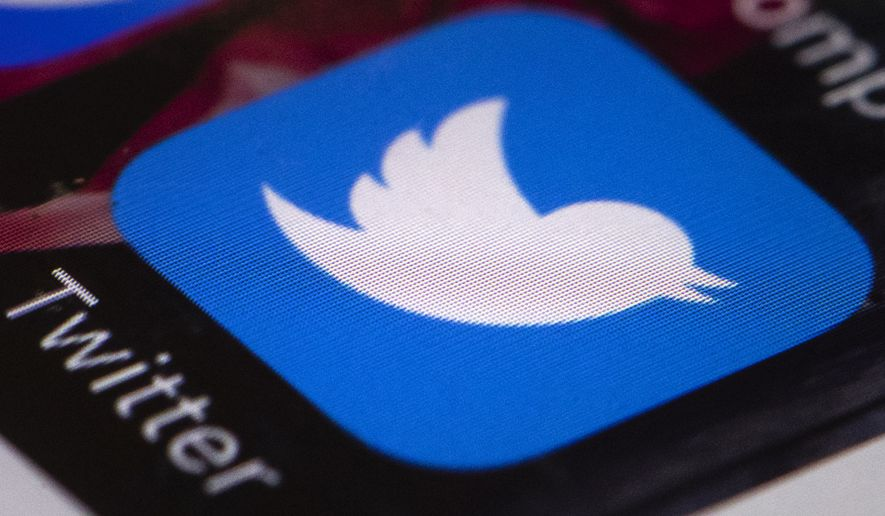 This April 26, 2017, file photo shows the Twitter app on a mobile phone in Philadelphia. (AP Photo/Matt Rourke, File)