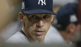 New York Yankees manager Joe Girardi reacts during the fourth inning of Game 1 of baseball's American League Championship Series against the Houston Astros Friday, Oct. 13, 2017, in Houston. (AP Photo/Tony Gutierrez)