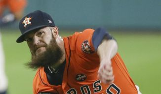 Houston Astros starting pitcher Dallas Keuchel throws during the first inning of Game 1 of baseball's American League Championship Series against the New York Yankees Friday, Oct. 13, 2017, in Houston. (AP Photo/Tony Gutierrez)