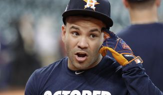 Houston Astros' Jose Altuve gestures during batting practice before Game 1 of the American League Championship Series baseball game against the New York Yankees Friday, Oct. 13, 2017, in Houston. (AP Photo/David J. Phillip)