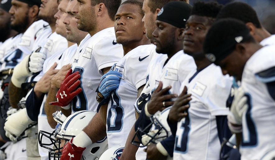 FILE - In this Aug. 8, 2016, file photo, Tennessee Titans wide receiver Rishard Matthews, center, and teammates listen to the national anthem before a scrimmage at NFL football training camp in Nashville, Tenn. Matthews spoke Friday, Oct. 13, 2017, and said he made a bad decision to tweet out that he would quit playing football if the NFL puts in a new rule on the national anthem. He quickly deleted the tweet, which someone caught via screen grabs.(AP Photo/Mark Zaleski, File)