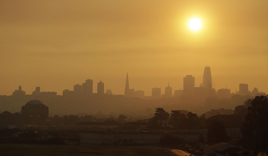 Smoke and haze from wildfires hovers over the skyline Thursday, Oct. 12, 2017, in San Francisco. Gusting winds and dry air forecast for Thursday could drive the next wave of devastating wildfires that are already well on their way to becoming the deadliest and most destructive in California history. (AP Photo/Eric Risberg)
