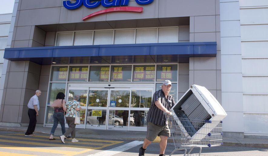 FILE - In this July 21, 2017 file photo, customers enter and leave the Sears store in St. Eustache, Quebec. Sears Canada has received court approval to liquidate all its remaining stores, putting 12,000 employees out of a job. Ontario Superior Court heard Friday, Oct. 13, that despite weeks of discussion, no viable buyer has been found. Justice Glenn Hainey approved Sears Canada's motion to liquidate its remaining 130 stores, and said he was satisfied there was no viable alternative. (Ryan Remiorz/The Canadian Press via AP, File)