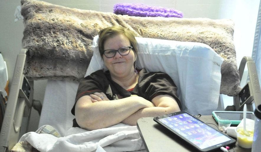 In this Sept. 18, 2017, photo, Altera Moore poses for a photo at Parke View Rehabilitation and Care Center in Burley, Idaho. Nearly a year after Moore was critically injured when she was hit by a car as she walked in a rain storm, she continues to fight to regain her mobility and rebuild her life. (Laurie Welch/The Times-News via AP)