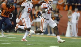 Clemson running back Tavien Feaster (28) crosses the goal line for a touchdown during the first half of an NCAA college football game against Syracuse, Friday, Oct. 13, 2017, in Syracuse, N.Y. (AP Photo/Adrian Kraus)