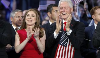FILE - In this Thursday, July 28, 2016 file  photo, Chelsea Clinton and former President Bill Clinton applaud as Democratic presidential nominee Hillary Clinton speaks during the final day of the Democratic National Convention in Philadelphia. Hundreds of college students from across the U.S. will be coming to Boston for a leadership conference created by former President Bill Clinton. Northeastern University is hosting the 10th annual Clinton Global Initiative University meeting on Friday, Oct. 13, 2017, which gathers students and experts in a variety of fields to discuss solutions to pressing problems. (AP Photo/Carolyn Kaster, File)