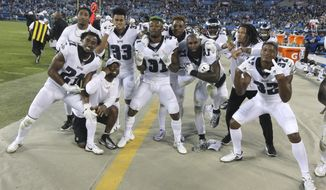 Philadelphia Eagles players celebrates in the final seconds of the second half of an NFL football game in Charlotte, N.C., Thursday, Oct. 12, 2017. (AP Photo/Bob Leverone)