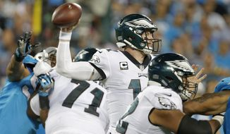 Philadelphia Eagles' Carson Wentz (11) looks to pass against the Carolina Panthers in the second half of an NFL football game in Charlotte, N.C., Thursday, Oct. 12, 2017. (AP Photo/Bob Leverone)