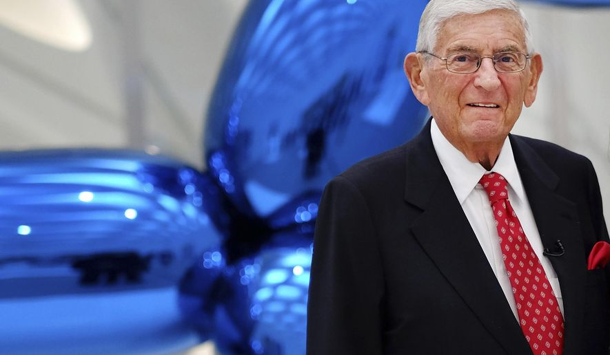 """FILE - In thisSept. 16, 2015 file photo Eli Broad poses for a photo at his museum, """"The Broad"""" in downtown Los Angeles. The billionaire-philanthropist announced Thursday, Oct. 12, 2017,  he is passing on responsibility for The Eli and Edythe Broad Foundation to its president, Gerun Riley. The foundation has a $2.5 billion endowment. (AP Photo/Richard Vogel, File)"""