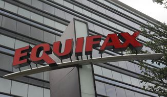 FILE - This July 21, 2012, file photo shows signage at the corporate headquarters of Equifax Inc. in Atlanta. Credit report company Equifax said Monday, Oct. 2, 2017, that an additional 2.5 million Americans may have been affected by the massive security breach of its systems, bringing the total to 145.5 million people who had their personal information accessed or stolen. (AP Photo/Mike Stewart, File)