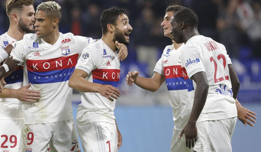 Lyon's Nabil Fekir, center, celebrates with his teammates after he scored a goal against Monaco during their French League One soccer match in Decines, near Lyon, central France, Friday, Oct. 13, 2017. (AP Photo/Laurent Cipriani)