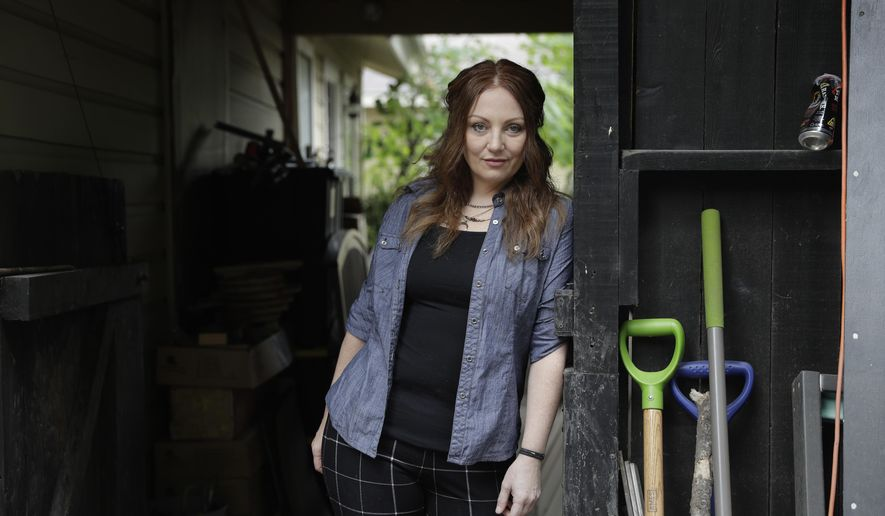 FILE- In this May 23, 2017, file photo, Dawn Erin poses for a photo at her home, in Austin, Texas. Erin was among more than 20 million Americans who gained coverage under the Affordable Care Act. She went nearly two decades without insurance before Obamacare and is terrified to go back to a life of relying on sporadic charity care. President Donald Trump's decision to end a provision of the Affordable Care Act that lowered out-of-pocket medical costs brought swift reaction Friday, Oct. 13 from the states, as health officials and consumers said they feared the action could chase millions of Americans away from coverage.(AP Photo/Eric Gay, File)