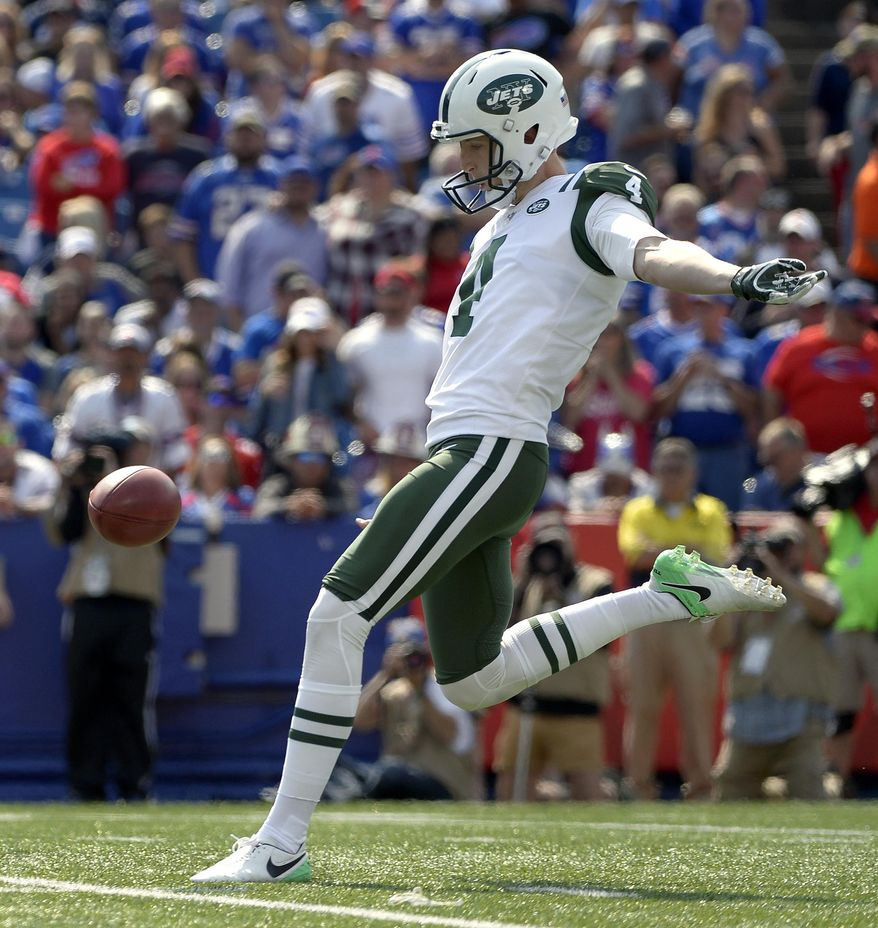 FILE - In this Sept. 10, 2017, file photo, New York Jets punter Lachlan Edwards (4) winds up to kick the ball during the second half of an NFL football game against the Buffalo Bills in Orchard Park, N.Y. Edwards spent the offseason fine-tuning his mechanics with former NFL punter and fellow Aussie Darren Bennett and has emerged this season as a much-improved player.  (AP Photo/Adrian Kraus)