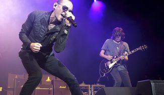 """FILE - In this May 16, 2015, file photo, Chester Bennington performs in concert during the MMRBQ Music Festival 2015 at the Susquehanna Bank Center in Camden, N.J. Bennington's band Linkin Park released an episode of """"Carpool Karaoke"""" on Oct. 12, 2017, that was taped in July, six days before Bennington took his own life on July 20. (Photo by Owen Sweeney/Invision/AP, File)"""