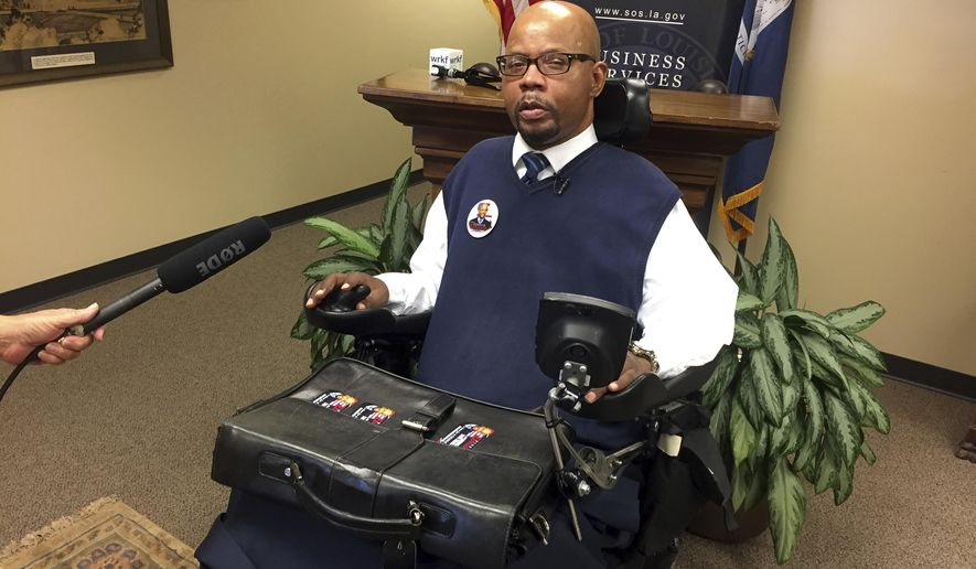 In this  July 12, 2017 photo, New Orleans attorney Derrick Edwards talks to reporters as he signs up as the only Democratic candidate to run for state treasurer in Baton Rouge. The major candidates vying to be Louisiana's next state treasurer are spending their final day ahead of Saturday's election trying to drum up interest for a low-interest race. (Mark Ballard/The Advocate via AP)