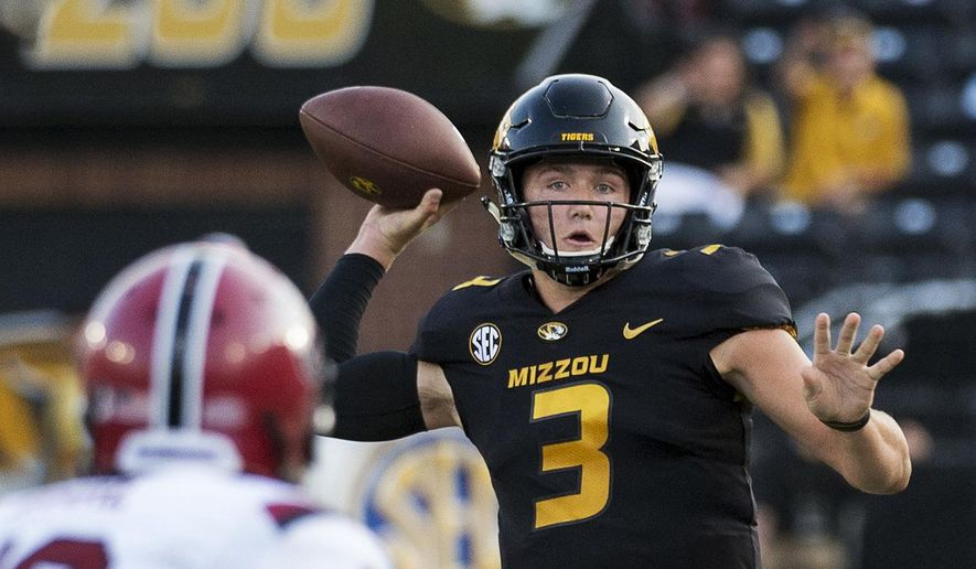 FILE - In this Sept. 9, 2017, file photo, Missouri quarterback Drew Lock throws a pass during the first quarter of an NCAA college football game against South Carolina, in Columbia, Mo. Missouri plays at No. 4 Georgia on Saturday. (AP Photo/L.G. Patterson, File)