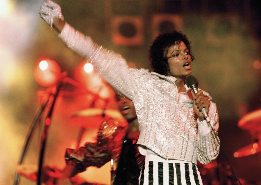 """FILE - In this July 1984 file photo, Michael Jackson performs during the """"Victory Tour."""" Julien's Auctions announced on Oct. 13, 2017, that a white glove Jackson wore on his """"Triumph"""" tour is among several  Jackson memorabilia items set to go up for bid on Nov. 4. (AP Photo, File)"""