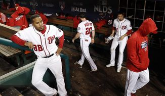 Washington Nationals' players walk in the dugout after the Chicago Cubs beat the Nationals 9-8 to to win baseball's National League Division Series, at Nationals Park, early Friday, Oct. 13, 2017, in Washington. (AP Photo/Alex Brandon)