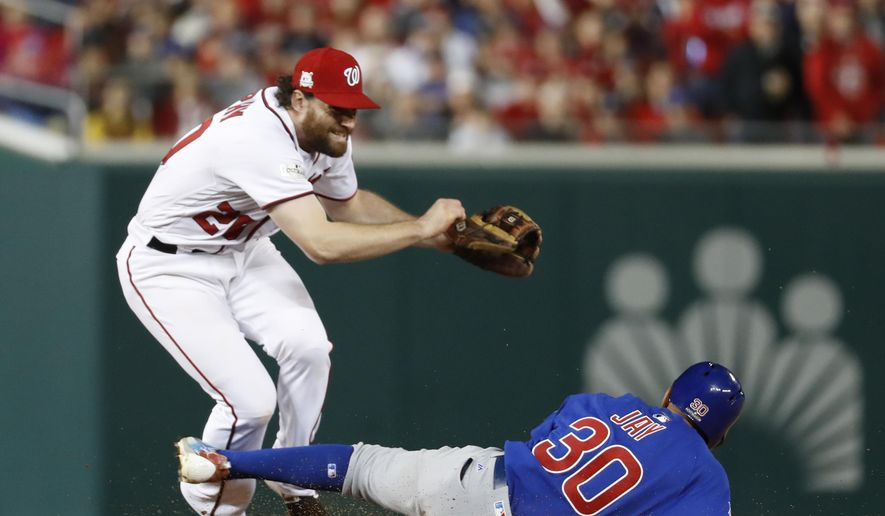 Washington Nationals second baseman Daniel Murphy (20) jumps after forcing out Chicago Cub's Jon Jay (30) on a ball hit by Kris Bryant, who was safe at first during seventh the inning of Game 5 of a baseball National League Division Series, at Nationals Park, Thursday, Oct. 12, 2017, in Washington. Kyle Schwarber scored on the play.  (AP Photo/Alex Brandon) **FILE**