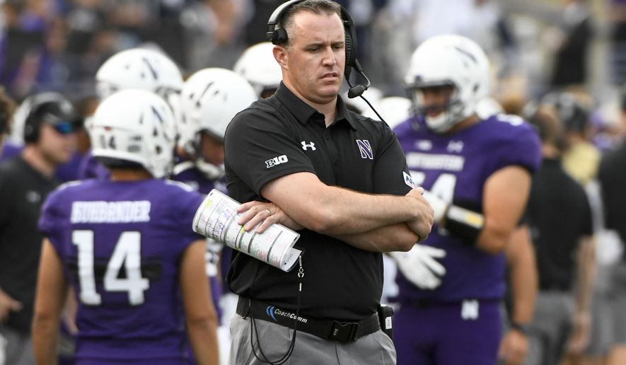 FILE - In this Sept. 2, 2017, file photo, Northwestern coach Pat Fitzgerald stands near the sideline during the second half of the team's NCAA college football game against Nevada in Evanston, Ill. Northwestern plays Maryland this week. Last week, Northwestern lost at home to Penn State 31-7 and Maryland was outclassed in a 62-14 rout at Ohio State. (AP Photo/Matt Marton, File)