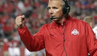 FILE - In this Sept. 30, 2017, file photo, Ohio State head coach Urban Meyer reacts to a play during the first half of an NCAA college football game against Rutgers in Piscataway, N.J. The Ohio State-Nebraska game matches two of the five programs with the most major-college football wins in history. (AP Photo/Mel Evans, File)